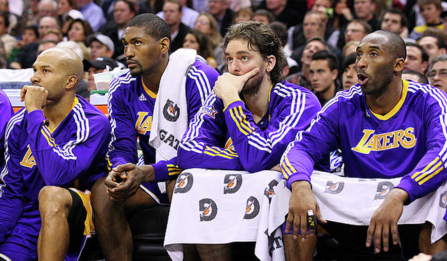 The Lakers'  Derek Fisher  (from left) Ron Artest, Pau Gasol and Kobe Bryant sit dejetced on the bench during second half action Tuesday Dec. 28, 2010 at the AT&T Center. The Spurs won 97-82. EDWARD A. ORNELAS/eaornelas@express-news.net Photo: EDWARD A. ORNELAS, SAN ANTONIO EXPRESS-NEWS / eaornelas@express-news.net