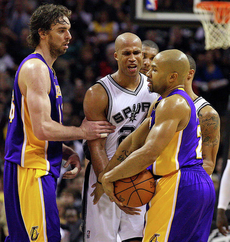 Lakers' Pau Gasol holds back Spurs' Richard Jefferson and he and  Lakers' Derek Fisher exchange words during second half action Tuesday Dec. 28, 2010 at the AT&T Center. The Spurs won 97-82. EDWARD A. ORNELAS/eaornelas@express-news.net Photo: EDWARD A. ORNELAS, SAN ANTONIO EXPRESS-NEWS / eaornelas@express-news.net