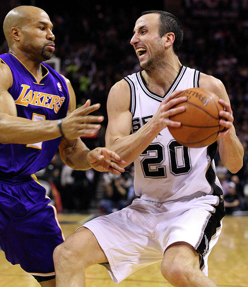 Spurs'  Manu Ginobili looks for room around Lakers' Derek Fisher during second half action Tuesday Dec. 28, 2010 at the AT&T Center. The Spurs won 97-82.  EDWARD A. ORNELAS/eaornelas@express-news.net Photo: EDWARD A. ORNELAS, SAN ANTONIO EXPRESS-NEWS / eaornelas@express-news.net