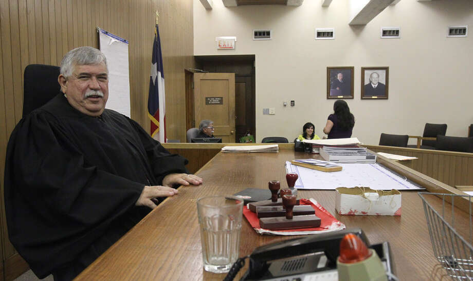 Judge Paul Canales spends one of his last days on the bench in County Court-at-Law No. 2 at the courthouse. Photo: John Davenport/Express-News