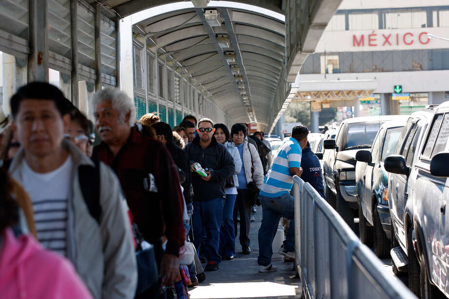 "Pedestrians line up to cross from Nuevo Laredo, Mexico. U.S. citizens without proper credentials are given a ""Noncompliant"" flier and sent on their way. Photo: Jerry Lara/Express-News"