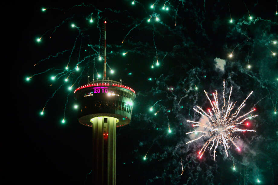 Fireworks burst behind the Tower of the Americas to ring in 2010. Photo: Express-News File Photo