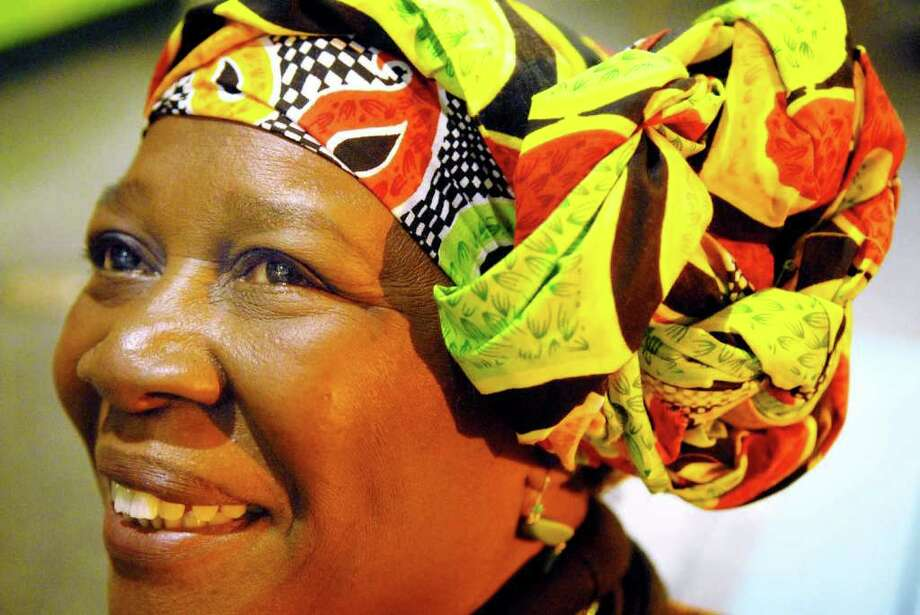 Geri Bell, one of the vendors at the 26th annual Capital Kwanzaa Celebration, wears the custom-designed African fabric that she designs and sells, Tuesday, Dec. 28, 2010, at the State Museum. (Luanne M. Ferris / Times Union ) Photo: Luanne M. Ferris