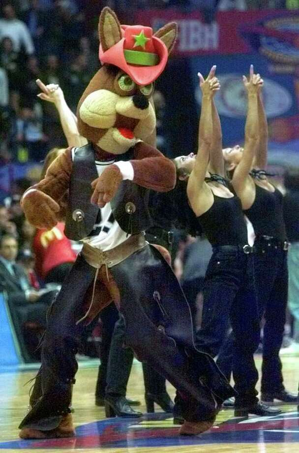 The Spurs Coyote along with the Silver Dancers entertain the crowd, with a Texas western theme skit, at the McDonald's Championship semifinal game between the Sopurs and Italy's varese Roosters Friday Oct. 15, 1999 in Milan.  DOUG SEHRES/STAFF Photo: DOUG SEHRES