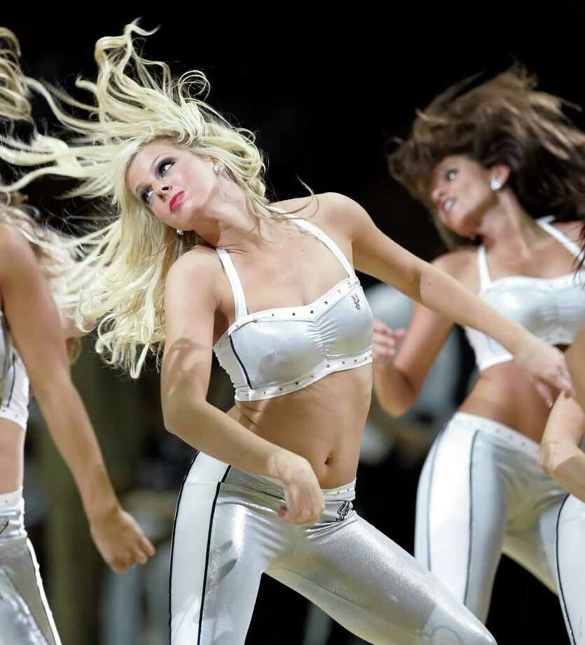 The Silver Dancers perform during a game against the Dallas Mavericks at the AT&T Center on November 4, 2008. Kin Man Hui/kmhui@express-news.net Photo: KIN MAN HUI, San Antonio Express-News / San Antonio Express-News