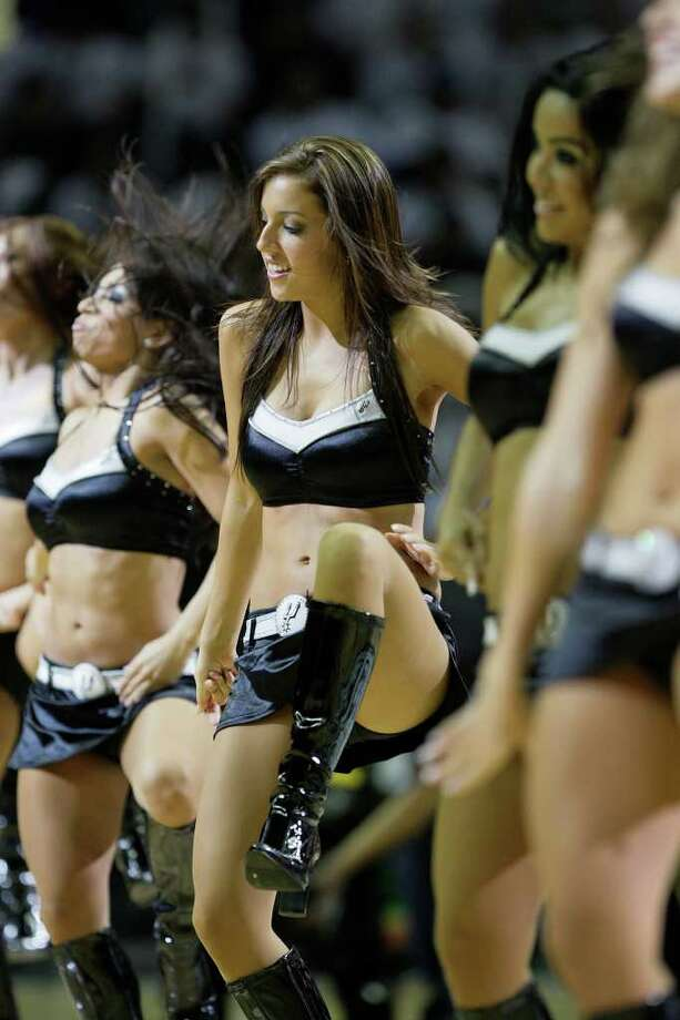 SPURS -- The Silver Dancers entertain the crowd during their season opener against the New Orleans Hornets at the AT&T Center, Wednesday, Oct. 28, 2009.  JERRY LARA/glara@express-news.net Photo: JERRY LARA, San Antonio Express-News / glara@express-news.net
