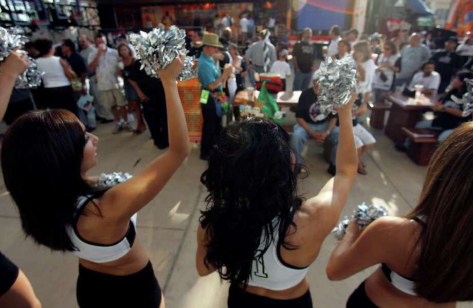 The Spurs' Silver Dancers welcome fans to game one of the NBA Finals at the SBC Center in San Antonio on June 9, 2005.. ( JERRY LARA STAFF ) Photo: JERRY LARA, SAN ANTONIO EXPRESS-NEWS / SAN ANTONIO EXPRESS-NEWS