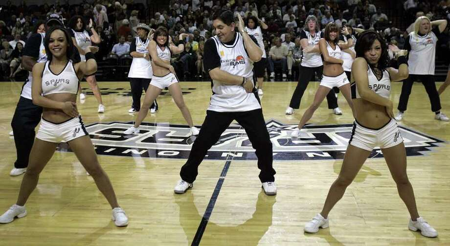 (For 210SA) Members of the Baseline Bums dance with the Silver Dancers at the last regular season game for the San Antonio Spurs, in San Antonio, Texas on Wednesday, April 18, 2007. Photo: ALICIA WAGNER CALZADA, SPECIAL TO THE EXPRESS-NEWS / Alicia Wagner Calzada
