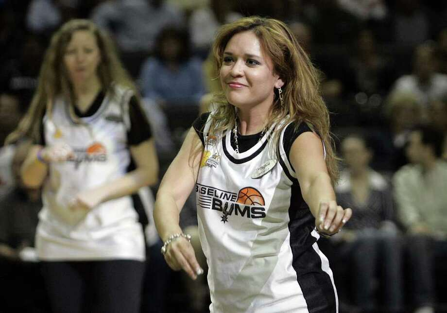 (For 210SA) Baseline Bum Michelle Angullo dances with the Silver Dancers at the last regular season game for the San Antonio Spurs, in San Antonio, Texas on Wednesday, April 18, 2007. Photo: ALICIA WAGNER CALZADA, SPECIAL TO THE EXPRESS-NEWS / Alicia Wagner Calzada