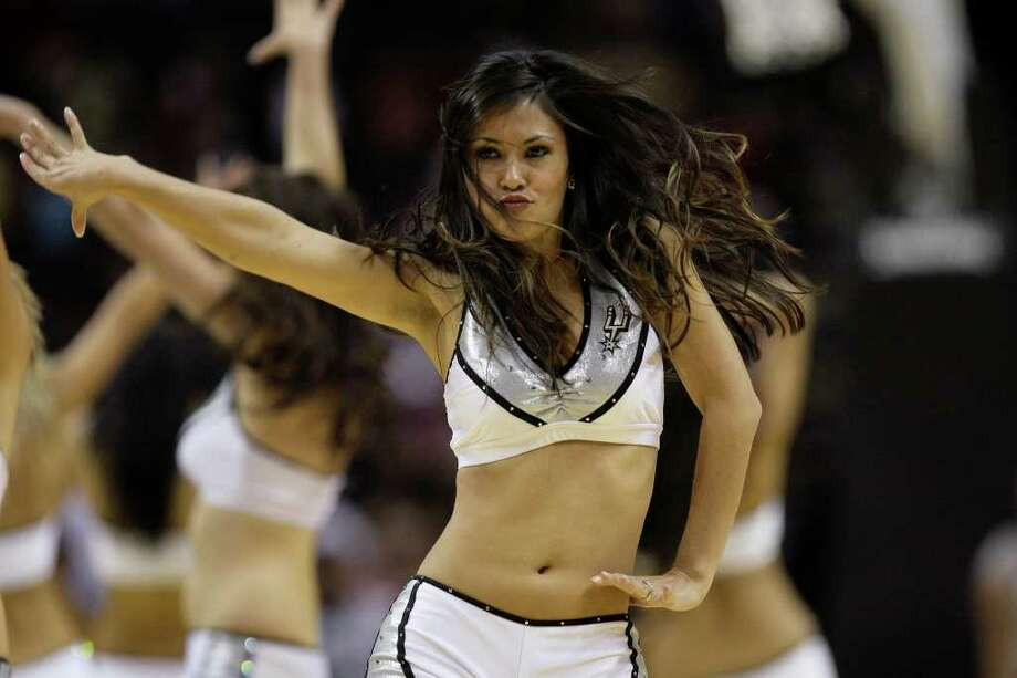 SPURS -- The Silver Dancers perform during half time at a San Antonio Spurs scriimmage in the AT&T Center, Sunday, Oct. 4, 2009. JERRY LARA/glara@express-news.net Photo: JERRY LARA, San Antonio Express-News / glara@express-news.net