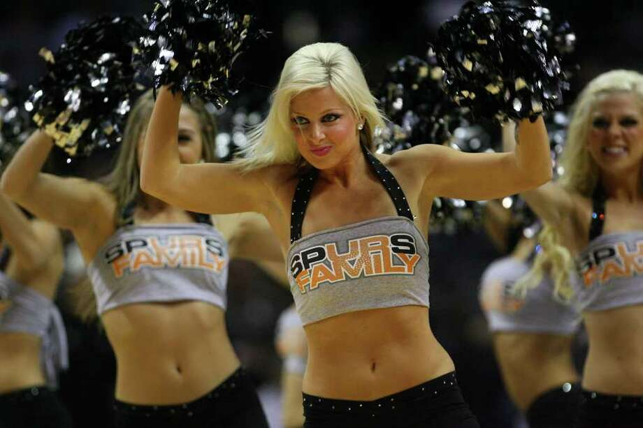 The Silver Dancers cheer during a break in the Spurs vs the Phoenix Suns at the AT&T Center, Sunday, February 28, 2010.  Final score Spurs 113, Suns 110. Jennifer Whitney/ special to the Express-News Photo: Jennifer Whitney, Special To The Express-News / spoecial to the San Antonio Express-News
