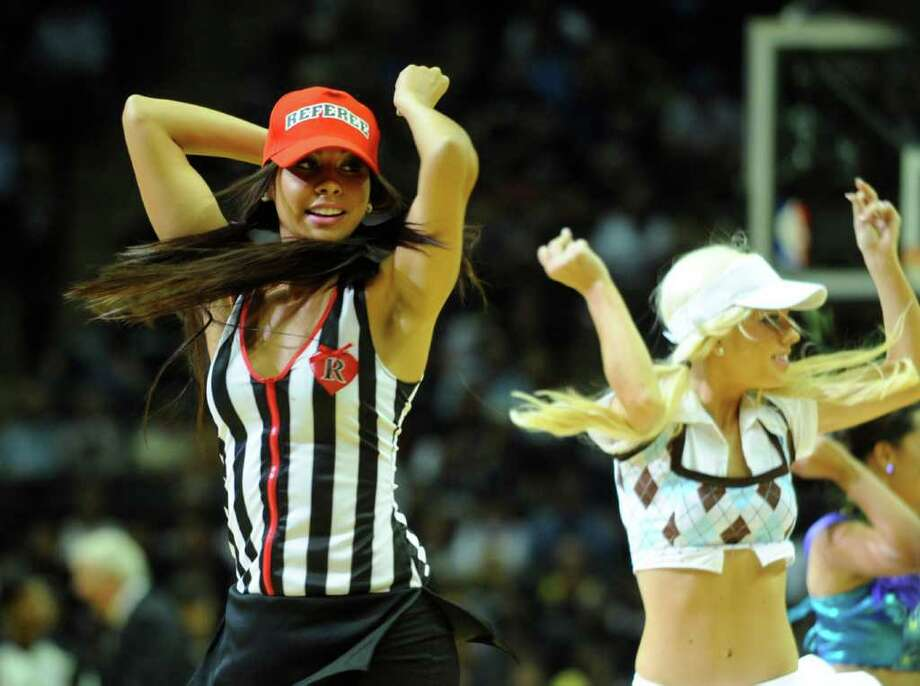 The San Antonio Spurs Silver Dancers perform in Halloween costume during at the AT&T Center on Saturday, Oct. 30, 2010. BILLY CALZADA / gcalzada@express-news.net  New Orleans Hornets at San Antonio Spurs Photo: BILLY CALZADA, SAN ANTONIO EXPRESS-NEWS / bcalzada@aol.com