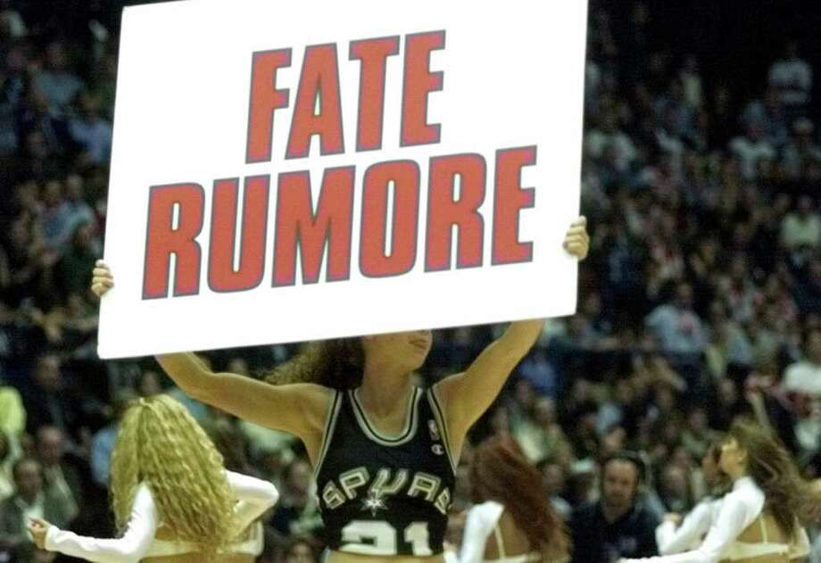 A dancer wearing a Spurs jersey carries a sign encouraging the Italian fans at the FilaForum in Milan to 'make noise' during the McDonald's Championship semifinal game with the Spurs against Varese Roosters Friday Oct. 15, 1999.  DOUG SEHRES/STAFF Photo: DOUG SEHRES