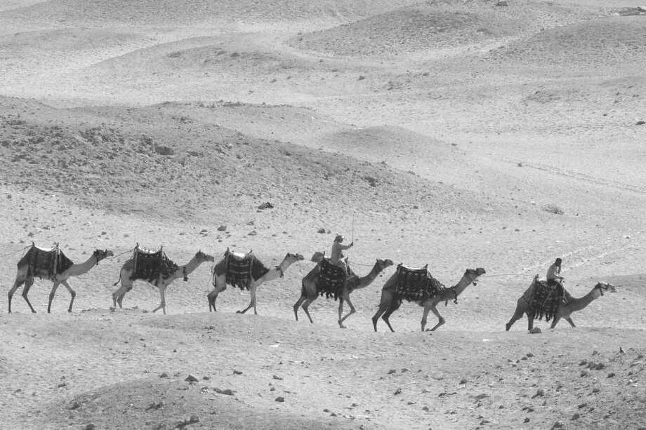 """Camel Caravan,"" by Greenwich photographer Av Rivel, is one of the works featured in Rivel's upcoming solo exhibit, ""Travels With My Camera"", which opens Jan. 16 at Les Beaux-Arts Gallery at Round Hill Community Church, 395 Round Hill Road. Photo: Contributed Photo / Greenwich Citizen"