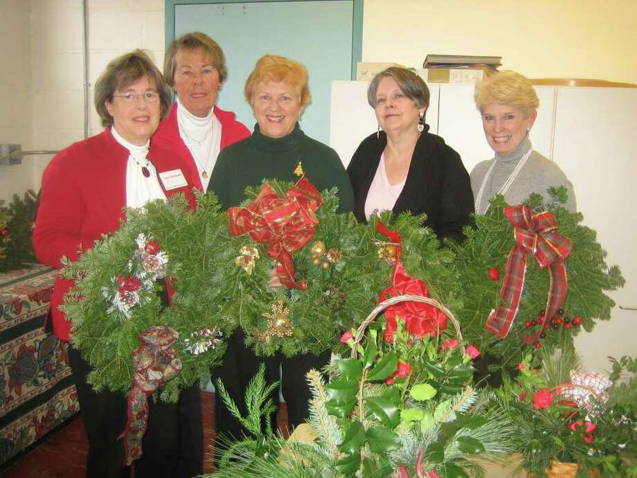 Members of the Greenfield Hill Garden Club met recently to decorate Christmas wreaths and create holiday centerpieces which were distributed to the Fairfield Senior Center and Operation Hope. Pictured are Lynne Sadlowski, co-vice president, Joan Fortuna, recording secretary, Joan Schmidt, co-vice president, Bonnie Rowe, president, and Pat Gardner, treasurer. Photo: Contributed Photo / Fairfield Citizen contributed