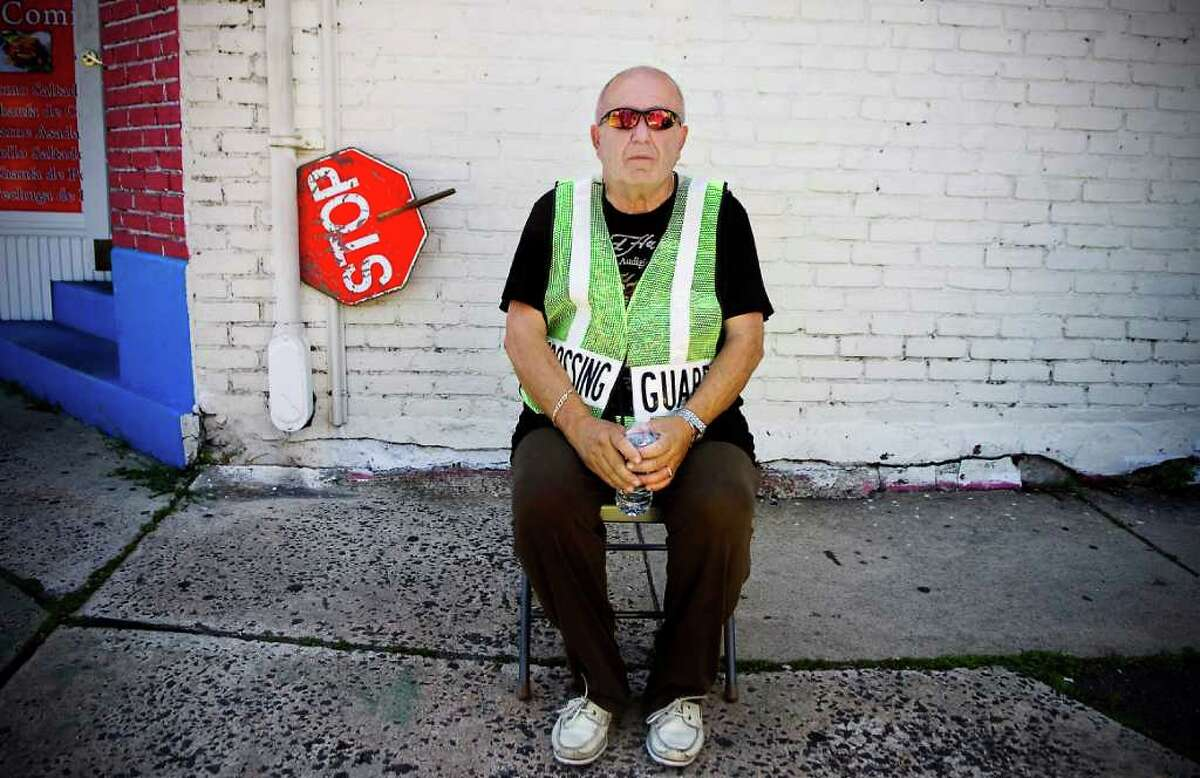 """John Musolini, 67, a lifelong Stamford resident. Musolini is a retired Pitney Bowes manager and part-time crossing guard on Hope Street. """"To me, the United States is the greatest country in the world. I served in the Army Reserve and in this country, even though we get in trouble, we all stick together. And guess what - we survive."""" Kathleen O'Rourke/Staff Photographer"""