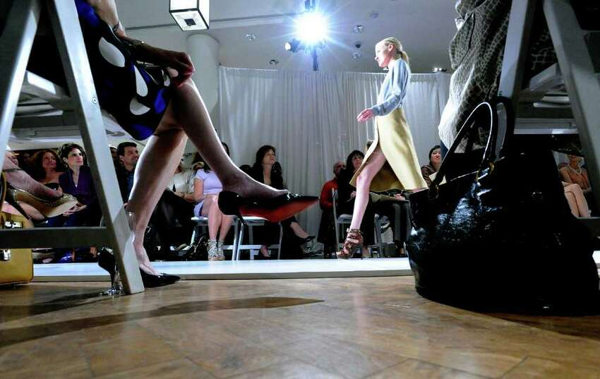 The craftsmanship of world-renowned designer Michael Kors on show as he recreates his Bryant Park Fashion Week 2010 show presenting his fall collection at Richards of Greenwich Tuesday, May 11, 2010. After the show Kors held a trunk show greeting flocks of shoppers. The trunk show will be hosted by Kors' associates at Richards running through Thursday and then move to Mitchells in Westport for Friday and Saturday.