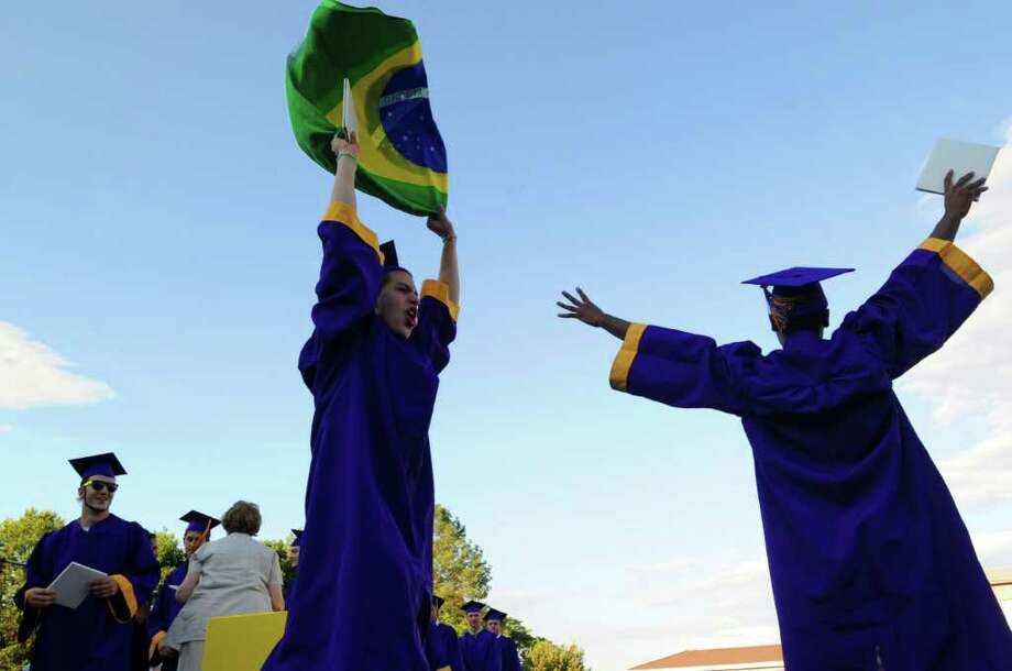Diego Larrosa and Vincent Hope celebrate their graduation while demonstrating support for the Brazilian soccer team during Westhill High School Class of 2010 Commencement Thursday, June 24, 2010. Photo: Keelin Daly, ST / Stamford Advocate