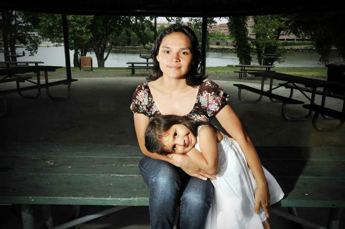 Celia Gonzalez, 25, photographed with her daughter Giselle Favian, 4, in Kosciuszko Park Tuesday June 22, 2010. Gonzalez moved to Stamford from El Salvador 6 years ago, she recently earned her high school diploma and is headed to college.