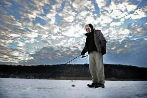 Ioan Stan, of East Haven, does some ice fishing Wednesday on the Housatonic River in Derby.