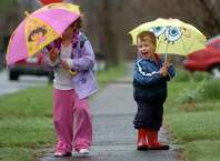 Two-year-old A.J. Zhawred and his sister Stella, 5, walk home from the bus stop in Fairfield Tuesday Mar. 30, 2010.