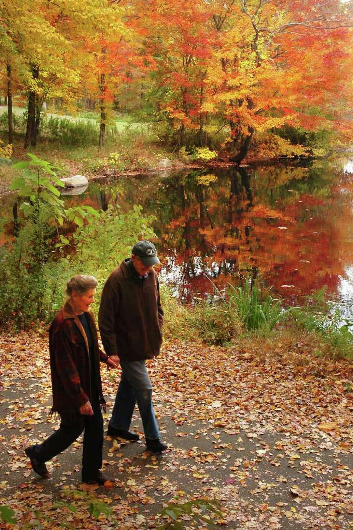 Muriel and Jean Bowen, of Trumbull, walk through Twin Brooks Park in Trumbull, Conn. Monday, Oct. 25th, 2010.