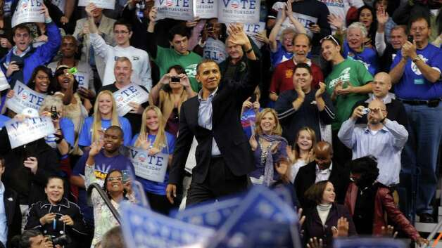 2010: President Barack Obama arrives at a rally at the Arena at Harbor Yard in Bridgeport. Photo: Ned Gerard / Connecticut Post
