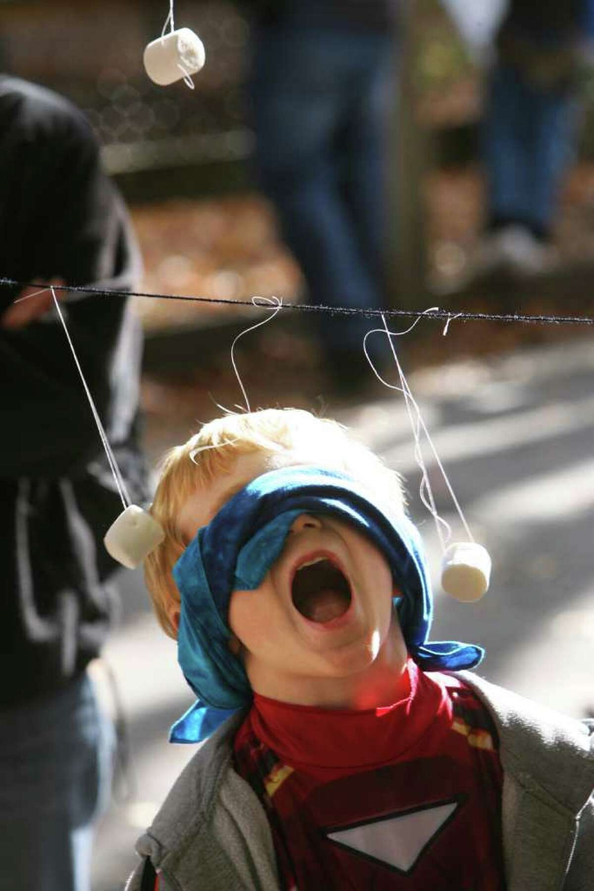 Will Eckert, 6 of Trumbull, plays a marshmallow game at the Beardsley Zoo Halloween party on Sunday, October 31, 2010.