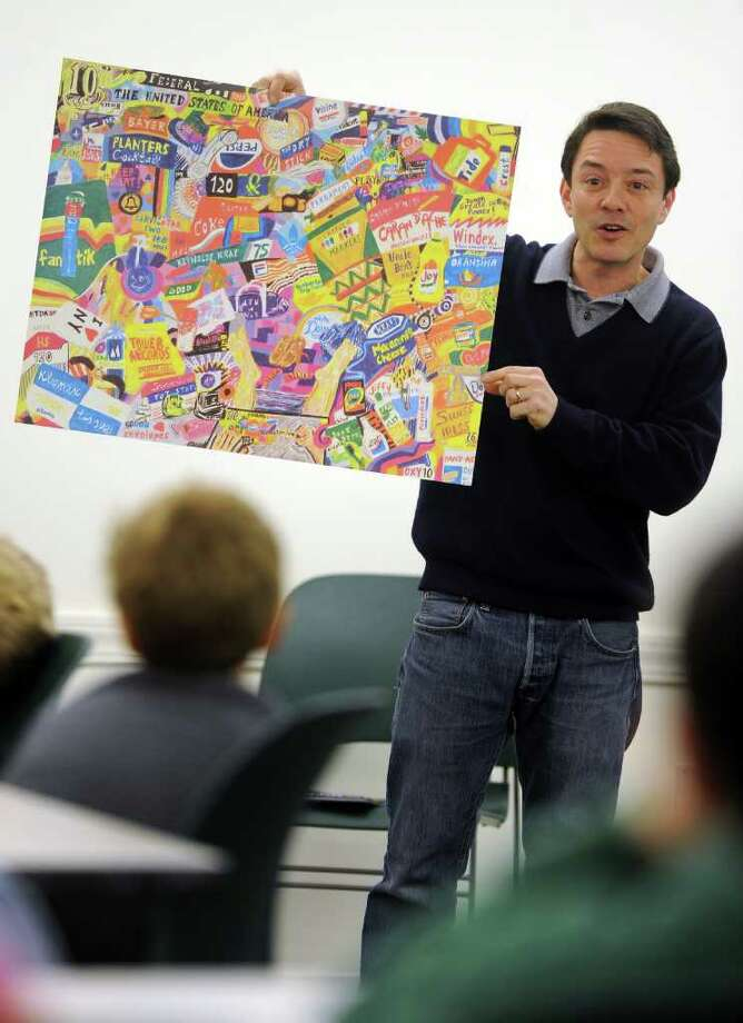 during a cereal box collage workshop conducted by artist Michael Albert at the Fairfield Public Library on Tuesday, December 28, 2010. Photo: Lindsay Niegelberg / Connecticut Post