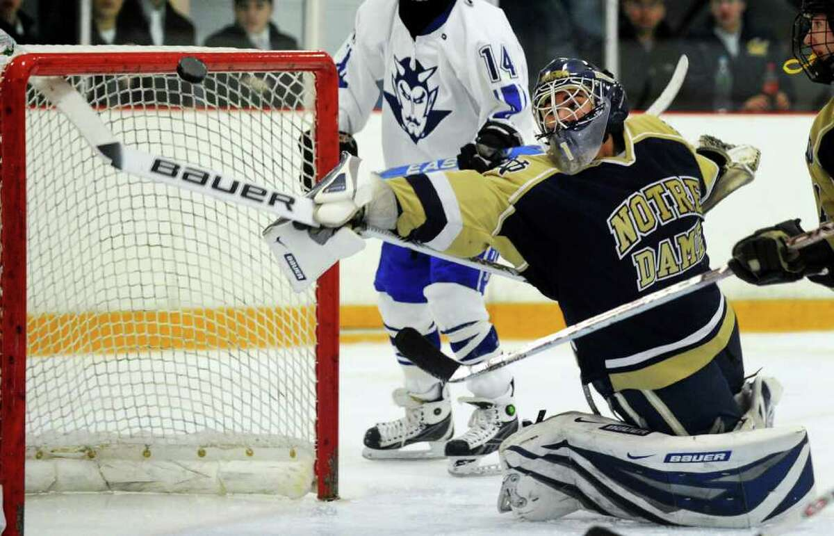 Notre Dame's goalie Eric Sugrue stretches out to intercept a wayward puck, during hockey action against West Haven in West Haven, Conn. on Wednesday Feb. 03, 2010.