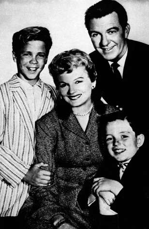 "FILE - In this undated file photo, from left, Tony Dow as Wally, Barbara Billingsley as June, Hugh Beaumont as Ward and Jerry Mathers as Beaver, the cast of the TV series ""Leave It to Beaver"", pose for a publicity portrait. Billingsley, who gained the title supermom for her gentle portrayal of June Cleaver, the warm, supportive mother of a pair of precocious boys in ""Leave it to Beaver,"" has died Saturday, Oct. 16, 2010. She was 94. (AP Photo/File) Photo: HO / San Antonio Express-News"
