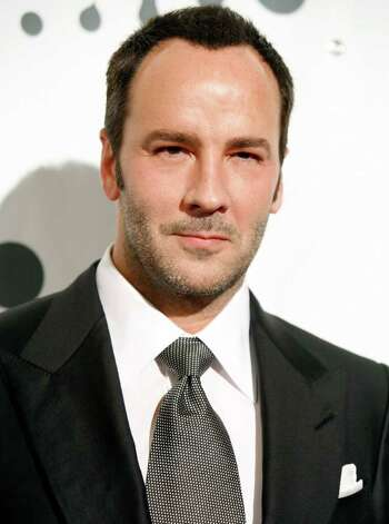"** FILE ** In this March 26, 2007, file photo, designer Tom Ford arrives to the 18th annual GLAAD media awards  in New York. Ford, who largely left the fashion world behind to try his hand in Hollywood, announced, Wednesday, Oct. 29, 2008, his first deal to direct a film. ""A Single Man,"" starring Colin Firth, Julianne Moore and Matthew Goode, is set to begin filming in Los Angeles on Monday. (AP Photo/Diane Bondareff, file) Photo: Diane Bondareff, STR / San Antonio Express-News"