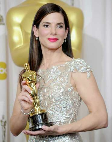 "HOLLYWOOD - MARCH 07:  (EDITORS NOTE: NO ONLINE, NO INTERNET, EMBARGOED FROM INTERNET AND TELEVISION USAGE UNTIL THE CONCLUSION OF THE LIVE OSCARS TELECAST)  Actress Sandra Bullock, winner Best Actress award for ""The Blind Side,"" poses in the press room at the 82nd Annual Academy Awards held at Kodak Theatre on March 7, 2010 in Hollywood, California.  (Photo by Jason Merritt/Getty Images) Photo: Jason Merritt, Staff / Getty Images North America"