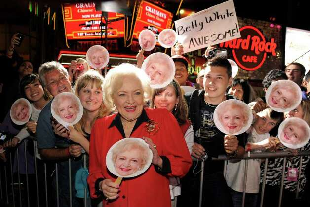 "Betty White, a cast member in ""You Again,"" poses with fans holding Betty White masks at the premiere of the film in Los Angeles, Wednesday, Sept. 22, 2010. (AP Photo/Chris Pizzello) Photo: Chris Pizzello, STF / AP"