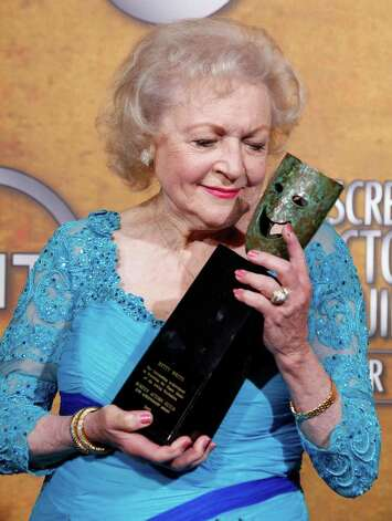 FILE - In this Jan. 23, 2010 file photo, actress Betty White poses backstage with the Life Achievement Award at the 16th Annual Screen Actors Guild Awards in Los Angeles.  White has been voted the Entertainer of the Year by members of The Associated Press.  (AP Photo/Reed Saxon, file) Photo: Reed Saxon, STF / AP