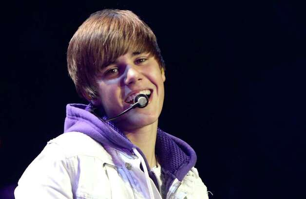 Canadian singer Justin Bieber performs in Vancouver, Canada on Tuesday Oct. 19, 2010. (AP Photo/The Canadian Press - Darryl Dyck) Photo: DARRYL DYCK, SUB / The Canadian Press
