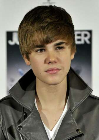 "MADRID, SPAIN - NOVEMBER 29:  Singer Justin Bieber attends ""My Worlds The Collection"" photocall at Urban Hotel on November 29, 2010 in Madrid, Spain.  (Photo by Carlos Alvarez/Getty Images) Photo: Carlos Alvarez, Stringer / Getty Images Europe"