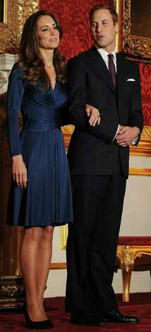 (FILES) A file photo taken on November 16, 2010, shows Britain's Prince William and his fiancee Kate Middleton posing for photographers during a photocall to mark their engagement, in the State Rooms of St James's Palace, central London.   Prince William will marry his long-term girlfriend Kate Middleton at Westminster Abbey on April 29 next year, St James's Palace announced Tuesday, November 23, 2010.       AFP PHOTO / BEN STANSALL / FILES (Photo credit should read BEN STANSALL/AFP/Getty Images) Photo: BEN STANSALL, Stringer / AFP