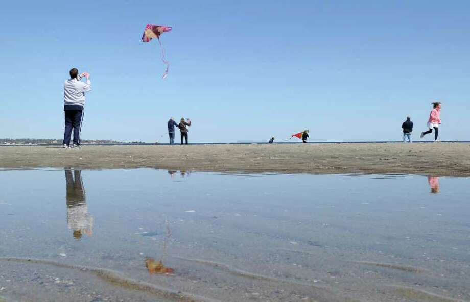 Jeff Seigel, left, of Briarcliff Manor, N.Y., launches his kite into a cloudless blue sky at Greenwich Point during the annual Kite Flying Festival, Saturday afternoon, April 10, 2010, Greenwich, Conn.  Seigel said he came into town especially for the festival. 4/10/10 GT photo = Kite-Flying Enthusiasts Soar To New Heights At The Point. by Bob Luckey Photo: Bob Luckey / Greenwich Time