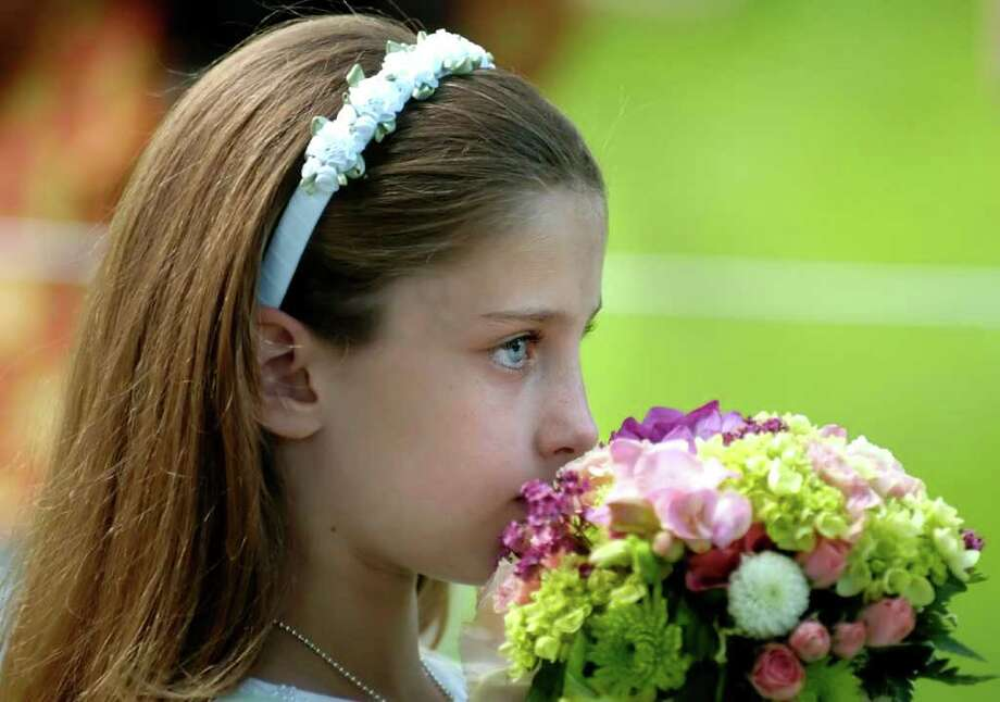 A Flower girl processes into the GA graduation, Thursday, May 27, 2010. Photo: Bob Luckey / Greenwich Time