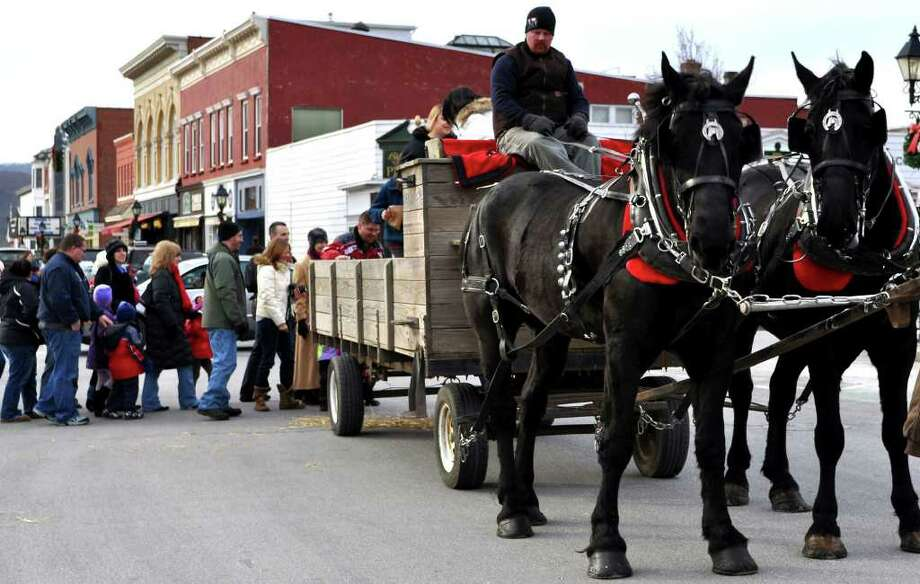 For the duration of the event, the line just keeps on growing for a memorable ride around the Village Green in New Milford aboard a horse-drawn hayride. Photo: Cristina Bernardi / The News-Times Freelance