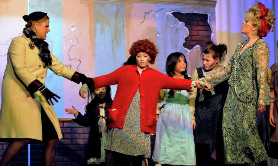 "The cast of the Woodlawn Theatre's 2010 production of ""Annie"" included (from left) Beth Balzar, Andrea Varnado, Tatiana Mirabent, Brooklyn Britton and Twyla LaMont . Photo: Courtesy Woodlawn Theatre"