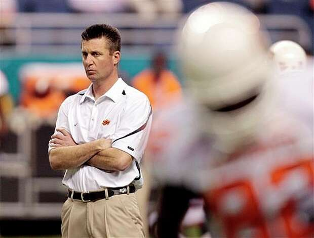 Oklahoma State coach Mike Gundy watches his team at the Alamodome. Photo: Eric Gay/Assocaited Press