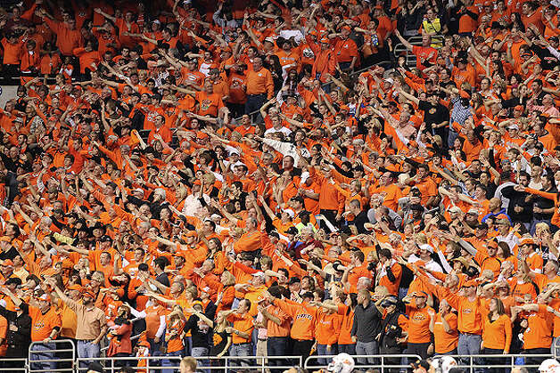 Oklahoma State fans cheer their team against Arizona at the 2010 Valero Alamo Bowl at the Alamodome in San Antonio on Wednesday, Dec. 29, 2010. Kin Man Hui/kmhui@express-news.net Photo: KIN MAN HUI, SAN ANTONIO EXPRESS-NEWS / kmhui@express-news.net