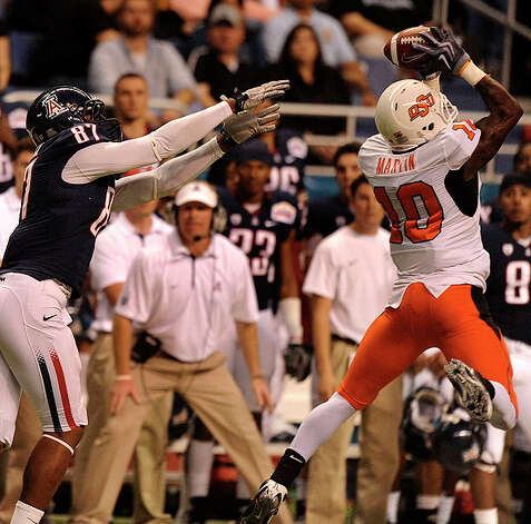 Oklahoma State receiver Markelle Martin (10) intercepts a pass that he would return for a touchdown as receiver Terrence Miler of Airzona reaches during the Valero Alamo Bowl in the Alamodome on Wednesday, Dec. 29, 2010. BILLY CALZADA / gcalzada@express-news.net Photo: BILLY CALZADA, SAN ANTONIO EXPRESS-NEWS / gcalzada@express-news.net