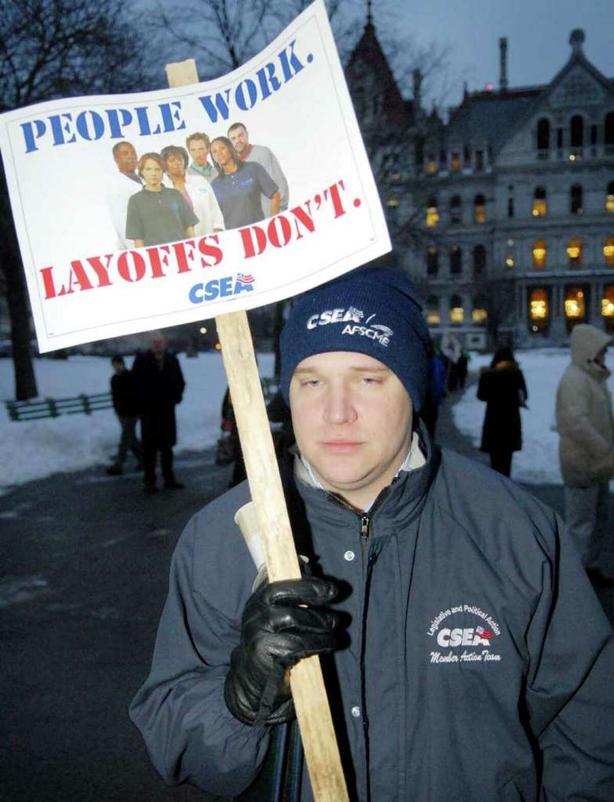 CSEA Political Action Dept. employee, Bryan Miller, of Albany joins PEF members for a candlelight vigil for state workers who have been earmarked for layoffs in Albany. (Luanne Ferris/Times Union)