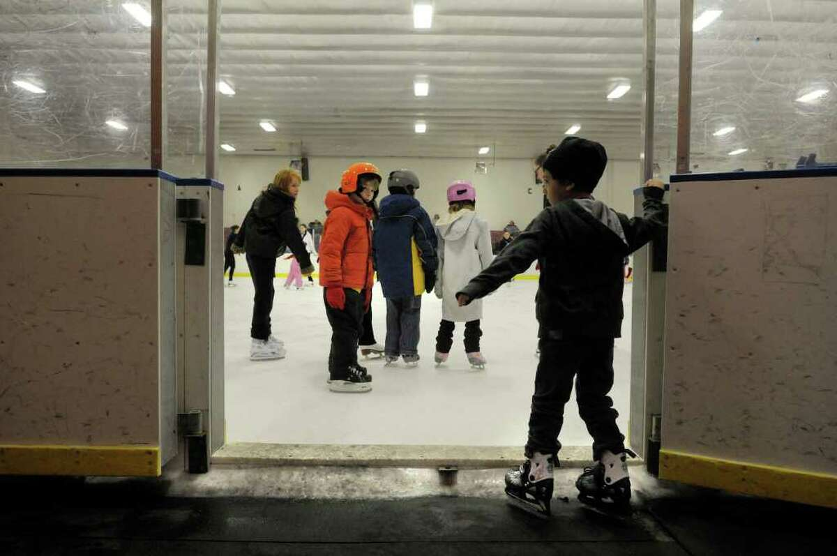 Young skaters make their way onto the ice for lessons Wednesday at the Albany Academy Field House. (Paul Buckowski / Times Union)