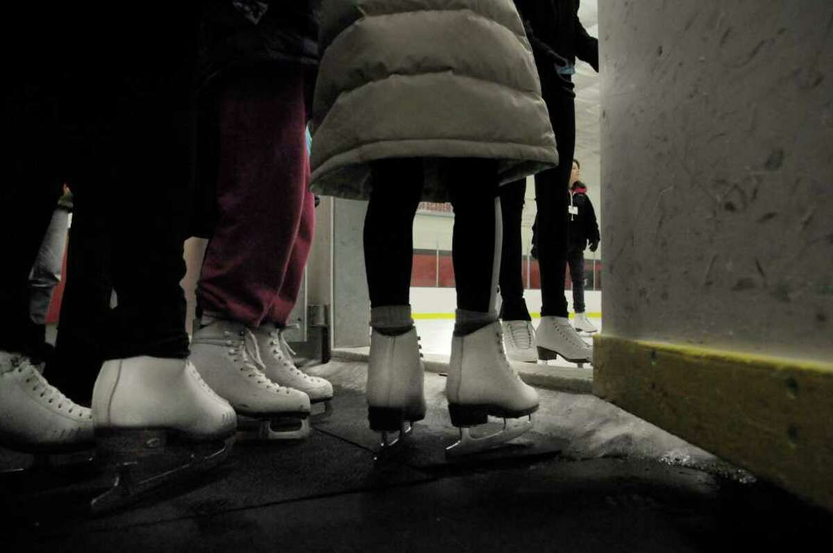 Young skaters make their way onto the ice for lessons Wednesday at Albany Academy Field House during the Albany Figure Skating Club's second annual SkateFest. (Paul Buckowski / Times Union)