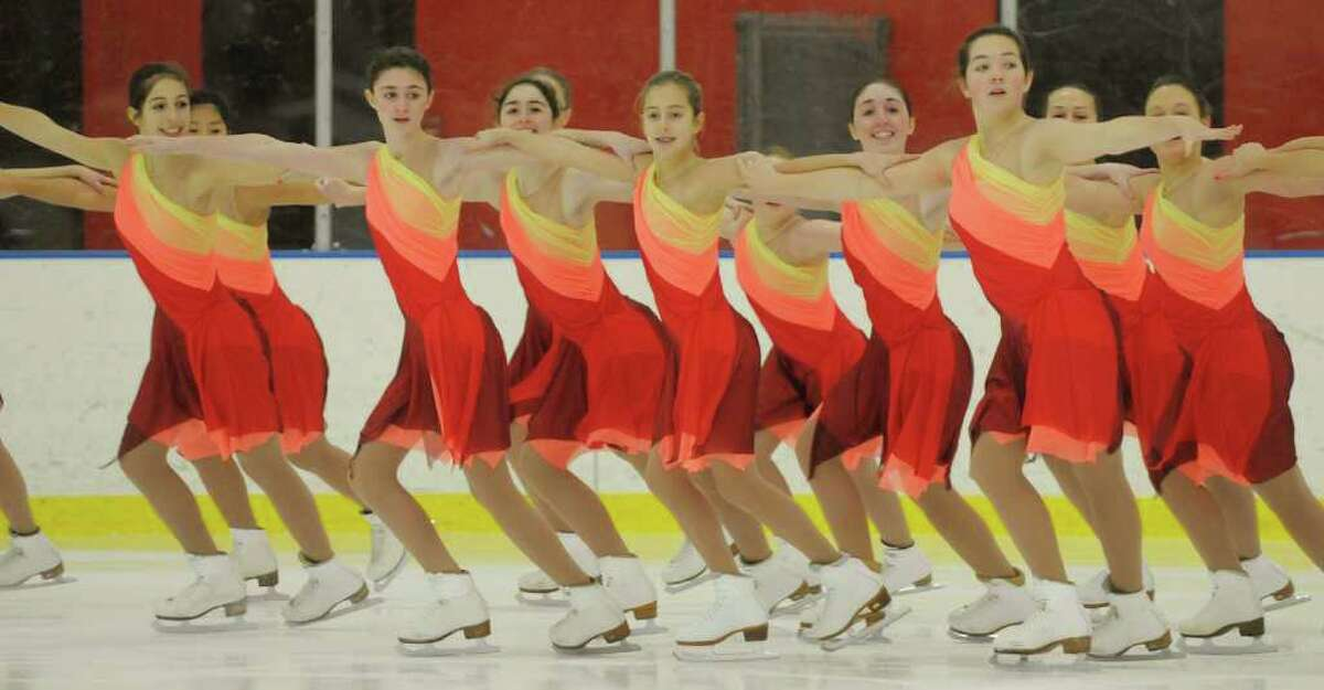 The Albany Figure Skating Club?s Achilles Synchronized Skating Team performs Wednesday at the Albany Academy Field House. (Paul Buckowski / Times Union)