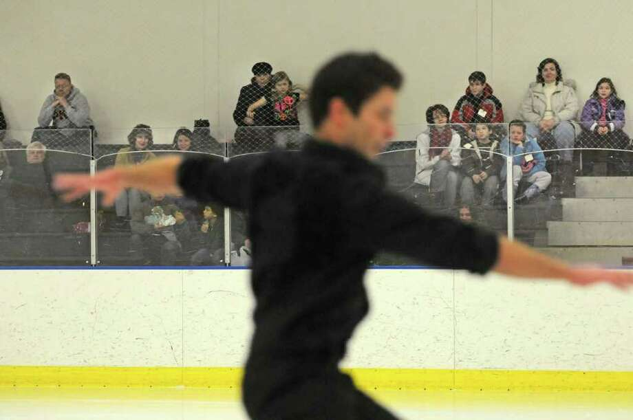 Justin Morrow of Saratoga Springs, a skater with the All Year Figure Skating Club, performs Wednesday at the Albany Academy Field House. (Paul Buckowski / Times Union) Photo: Paul Buckowski / 00011567A